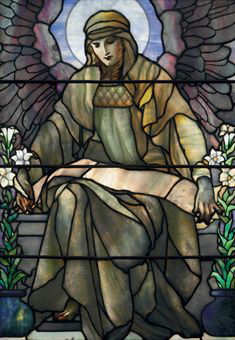 Tiffany Studios A LEADED GLASS WINDOW OF AN ANGEL, CIRCA 1910